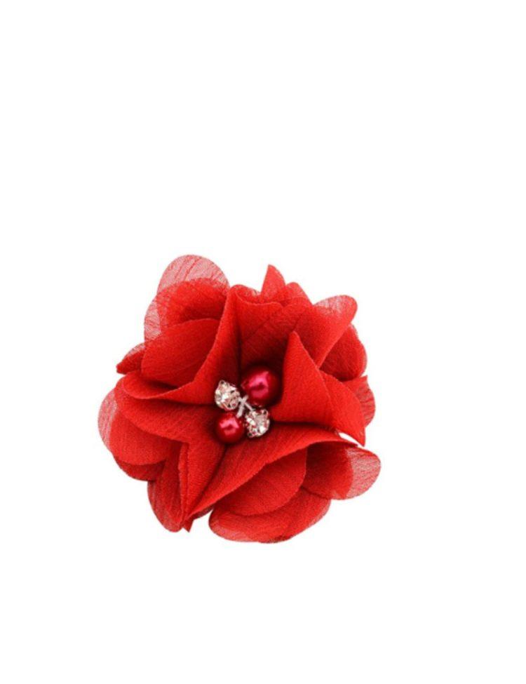 Rode haarbloem met parels in het midden