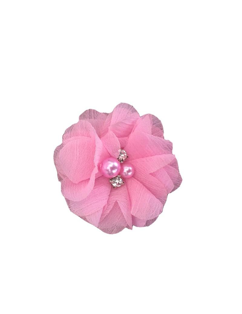 roze haarbloem met pareltjes in het midden
